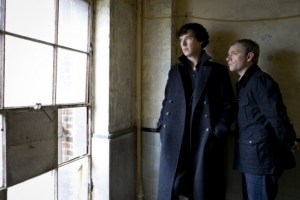 Sherlock and John look out of a window